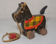 """Fisher-Price Wooden Kiltie Dog measures about 7.25"""" tall x 8.25"""" long x 2.75"""" deep and has the Fisher-Price Toys black logo. Kiltie's wheels roll and tail wags when pulled. Year Made: 1936. Toy is in good condition with surface wear as shown in photos.   eBay!"""