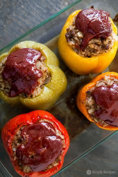 One of our favorite dinner recipes! Colorful bell peppers stuffed with a mixture of ground beef, onions, garlic, tomatoes, and rice, and baked until done and delicious. Topped with a ketchup-based sauce with Worcestershire sauce and Tabasco. So good!