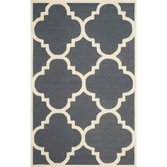 Anchor your living room seating group or define space in the den with this hand-tufted wool rug, featuring a trellis print in dark grey.