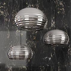 Flos Splugen Brau, lampada a sospensione in alluminio protetto da una vernice trasparente.