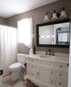 what an amazing bathroom remodel. This is what we need to do- frame the mirror, light fixture like that.