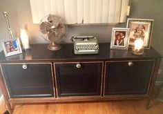 Oh the accents!! Love love love  Silver accent picture frames  Mint condition retro typewriter and fan GORGEOUS what a great mix  This dresser houses everything from DVD's to coloring books for the little one
