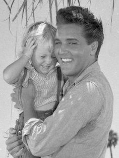 Elvis & Pam Ogles. One of his little co stars from his movie Follow That Dream