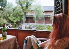 Relaxing in a cafe in Lijiang, Yunnan Province, China, Studio Mali, Travel, Adventure, Travel Bloggers, Western China, Cool Places to Visit, red hair, backpacking