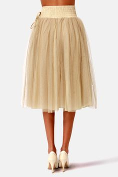 """Bust out your best ballerina moves in the girly and twirly, Lavand Twirl Next Door Beige Tulle Skirt! A woven waistband with tiers of tonal top-stitching has a decorative drawstring perched on the hip, plus smocked elastic across the back for the perfect fit. Beige-y taupe tulle flows from the high-waisted cut into a gorgeous midi-length skirt with the perfect amount of """"poof"""". Fully lined. Model is wearing a size small. 100% Polyester. Machine Wash Cold."""