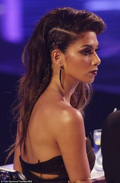 Tribal: Nicole's hair was pulled into a deep side parting, with one side french braided back to create a undercut without shaving the hair