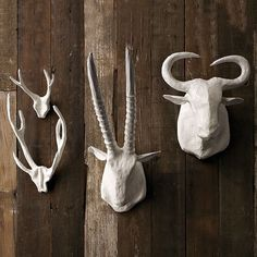 A grouping/line of antlers would look fantastic over your fireplace where the brick stops. The white gives it a modern rustic feel and would pop off the blue wall.    Papier-Mâché Animal Sculptures eclectic accessories and decor