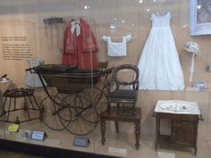Museum display of children's and baby's clothing and accessories