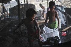 Manila, Philippines: Child labourers work in the charcoal dump in the Port area district