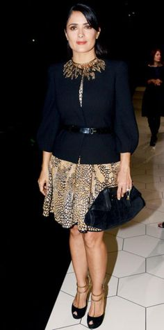 OCTOBER 3, 2012 Salma Hayek Pinault WHAT SHE WORE At Paris Fashion Week, Hayek Pinault arrived for the Alexander McQueen show in a printed dress. A belted black topper, the label's suede clutch, a wheat Aurelie Bidermann bib necklace and gold-accented T-straps completed the look.