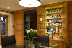 The stunning bespoke cupboards are beautifully crafted to provide the perfect storage space
