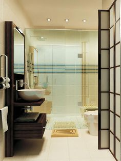 Using a wall-mounted vanity and sink frees up floor space, making a small bathroom feel spacious while remaining functional. In this design by Marie Burgos, the frameless glass shower door again helps to make the space feel more continuous.