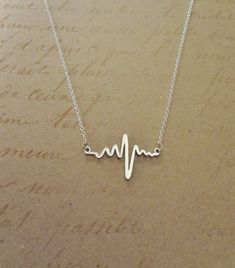 Electrocardiogram EKG Rhythm Heart Beat Necklace- Simplistically Beautiful and a wonderful statement on many levels. Perfect for anyone in the medical field or who appreciates anatomy! #necklace