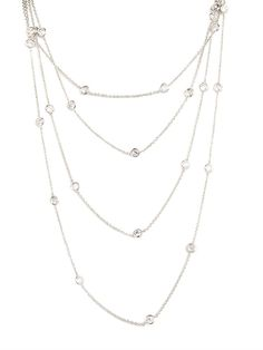 We love the layered look, especially when it involves gorgeous ice-white crystals and delicate chain links. That's why we're mad for this delicate statement necklace, which offers a quick hit of elegant glamour.