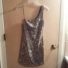 "Formal Dress. Gold/bronze sequin dress with one shoulder strap by Lily Rose. Size small. Worn once for a few hours. Excellent condition. No flaws, no missing sequins. 94% poly, 6% spandex. Model is 5' 3"". Will fit size 0-2 only. This dress is absolutely gorgeous on. Lily Rose Dresses"