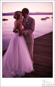 West shore cafe wedding lake tahoe sunset boats lake pier dock wedding portraits bride and groom moment