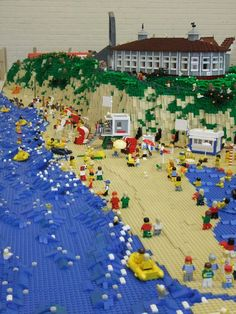 LEGO Beach. Pic saved by Iolanda Spruhde, not sure if she made it...it looks a lot like a Deborah Higdon house on the cliffs there... :)