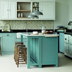 Blue kitchen cupboards, Spanish tiles. For more small kitchen decorating ideas, click the picture or see http://RedOnline.co.uk?utm_content=buffere4723&utm_medium=social&utm_source=pinterest.com&utm_campaign=buffer