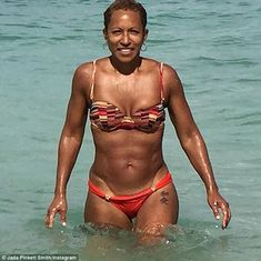 Three generations: On Wednesday she shared an insight into her genetic blessings when she posted a snap of her own mother, Adrienne Banfield-Jones, emerging from the sea - defying her years and gravity in a red bikini
