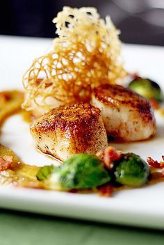 Seared Scallops with Golden Raisin Puree and Bacon Braised Brussels Sprouts