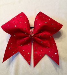 This holiday bow is made from a soft velvet material. Adorned with large and small rhinestones for that little bit of glimmer. Cute Cheer Bows, Cheerleading Bows, My Fantasy World, Rhinestone Bow, Velvet Material, Fabric Bows, Girls Hair Accessories, 1st Christmas, Baby Bows