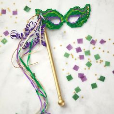 Celebrate Mardi Gras with a fun mask you create from Perler beads. Assembly is quick and easy!