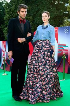 ulyana,  Are these two people actually going to the same function?  That skirt and chambray shirt combo should not be going to the same place as that guy's suit.
