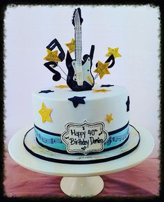 Count down themed 40th birthday party with a musical themed cake complete with fondant base guitar topper, edible image music sheet wrap & fondant music notes and stars on wires!
