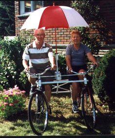 Cute old people + awesome bike + umbrella.