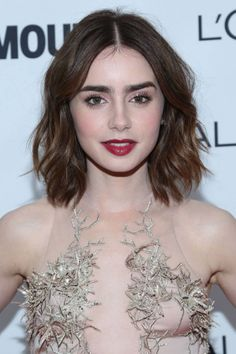 lilly collins, medium dark hair. medium hair styles - like the cut... not sure about the center part on me...