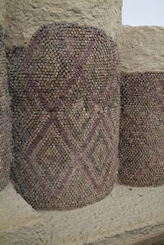 """the """"Mosaic Court"""" at the sacred Eanna precinct dedicated to the goddess Inanna from Uruk, southern Mesopotamia, Sumerian civilization (modern Warka, southern Iraq) Uruk IV period, ca 3000 - 3100 BC  This building and its columns were made of small mud bricks, which were then faced with a layer of mud plaster. Red, white, or black baked clay cones were then pushed into the mud plaster walls, creating colorful geometric patterns along the pillars and walls. by kairoinfo4u, via Flickr"""