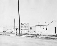Photo of Housing development with sign  Los Angeles housing development, about 1950  (Courtesy of Southern California Library for Social Studies and Research)