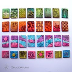polymer clay, colorbox chalks, embossing powder, head pins by Jana Lehmann. ~I love the pink, purple and blue one.