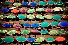 Positano umbrellas. www.solidandstriped.com