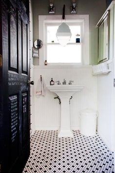 Bathroom - love the beehive tile under the pedestal sink, against the beadboard.