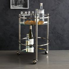Round cocktail trolley, with clear glass top shelf, mirrored glass bottom shelf, and polished nickel-finished frame, W48 x D44 x H61cm