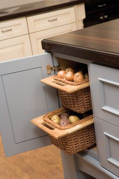 Open weave baskets offer popular pantry storage for onions and potatos that need the air circulation and work great on a kitchen island.