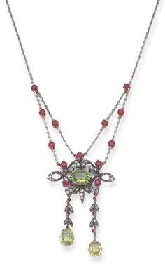 A BELLE EPOQUE PERIDOT, RUBY, DIAMOND, SILVER AND GOLD NECKLACE, circa 1910
