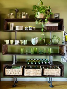 Eclectic Green Kitchen With Pine and Pipe Shelves