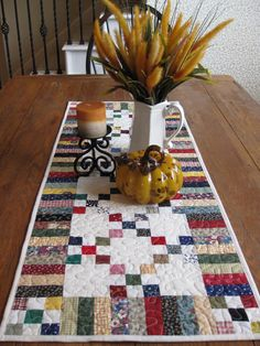This scrappy five patch table runner is made with cotton fabrics in so many different prints and solids I gave up counting. It works great Table Runner And Placemats, Table Runner Pattern, Quilted Table Runners, Small Quilt Projects, Quilting Projects, Crafty Projects, Quilting Ideas, Quilt Patterns, Place Mats Quilted