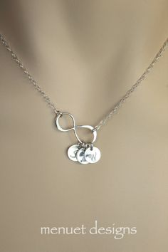 This necklace features sterling silver infinity charm and sterling silver disc(s), with your choice of initial(s). All charms and findings are