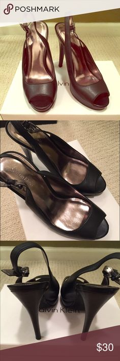 "Calvin Klein Black Peep Toe Slingback Heels Worn once, excellent condition. Only visible wear is on bottom of shoe (as seen in photo). Made of leather. Heel measures approx. 4.25"". Has buckle ankle strap and small platform. Shoes cleaned and sanitized. Calvin Klein Shoes Heels"