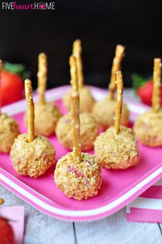 Strawberry Graham Cheese Ball Bites ~ Strawberry cheesecake balls rolled in graham cracker crumbs and skewered with a pretzel. Just Desserts, Delicious Desserts, Dessert Recipes, Yummy Food, Tasty, Cream Cheese Ball, Strawberry Cream Cheese Frosting, Sweet Recipes, Vegan Recipes