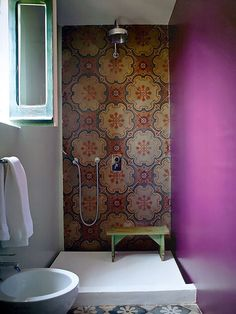 Daring tile, but not too much. Can paint the wall anytime your mood changes to  calm it down or kick it back up again.