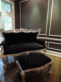 black room with black sofa