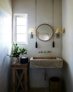 Check out this #rustic bathroom decor idea with a concrete sink and pulley mirror. Love it! #BathroomDesign #HomeDecorIdeas @istandarddesign