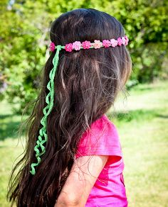 Flower Headband:  Not a free pattern, but it really doesn't look too complicated at all!  So cute!  I love this one!!  I love the colors, and it would be cute in white even for a wedding...