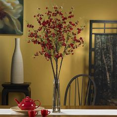 Add elegance to any space with a decorative 40-inch cherry blossom flower arrangement. This silk plant features durable polyester construction and comes in a lovely glass vase.