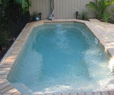 The best fiberglass swimming pools in the Daytona Beach, FL region. The best designs and colors to choose from. Contact us to learn more and get into a pool today! Fiberglass Pool Cost, Fiberglass Swimming Pools, Swimming Pool Sales, Swimming Pool Designs, Pool Contractors, Pool Shapes, Pool Installation, Backyard Pool Designs, Luxury Pools