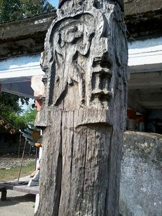 Dwajasthambam wood carving, about 600 years old, at a Hindu temple in a Southern Indian village in Tamil Nadu. The abandoned temple is now being renovated and restored.